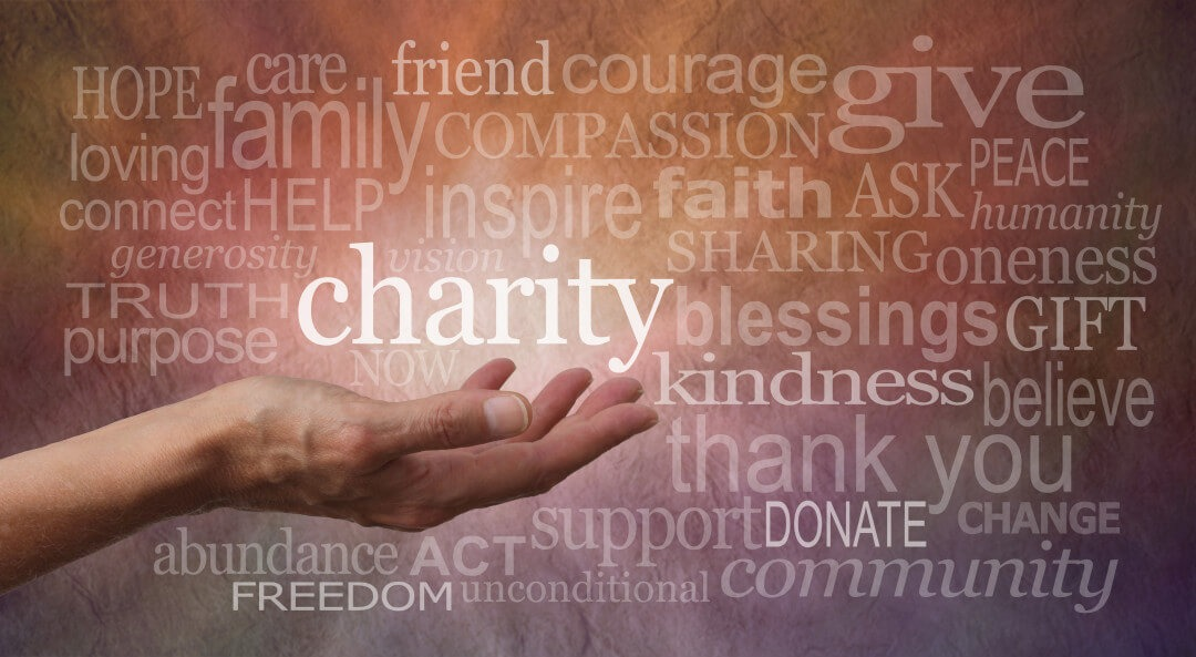 Hand with charity word cloud
