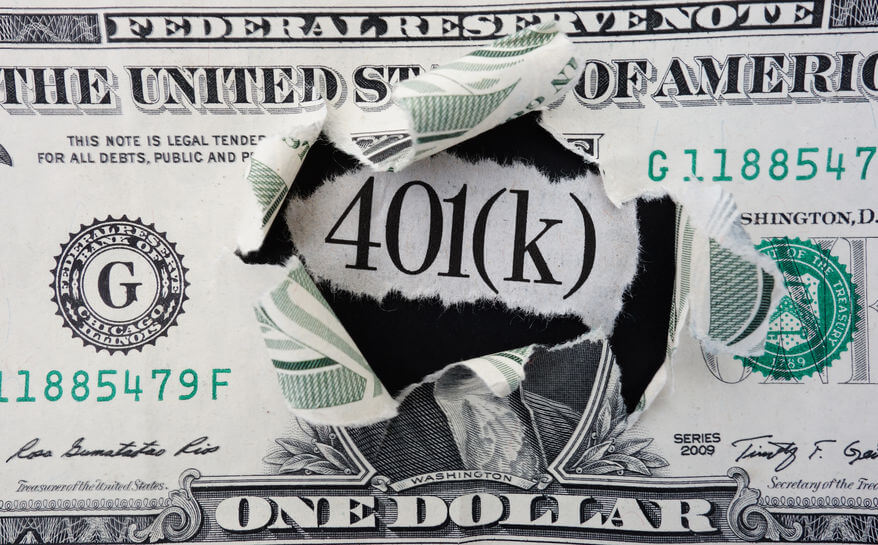401k in center of torn dollar bill