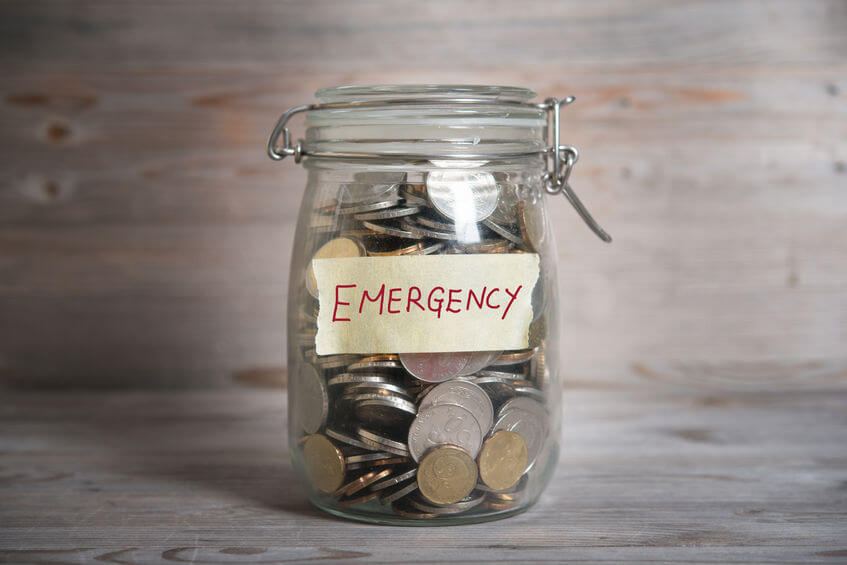 Jar of coins with emergency written on it